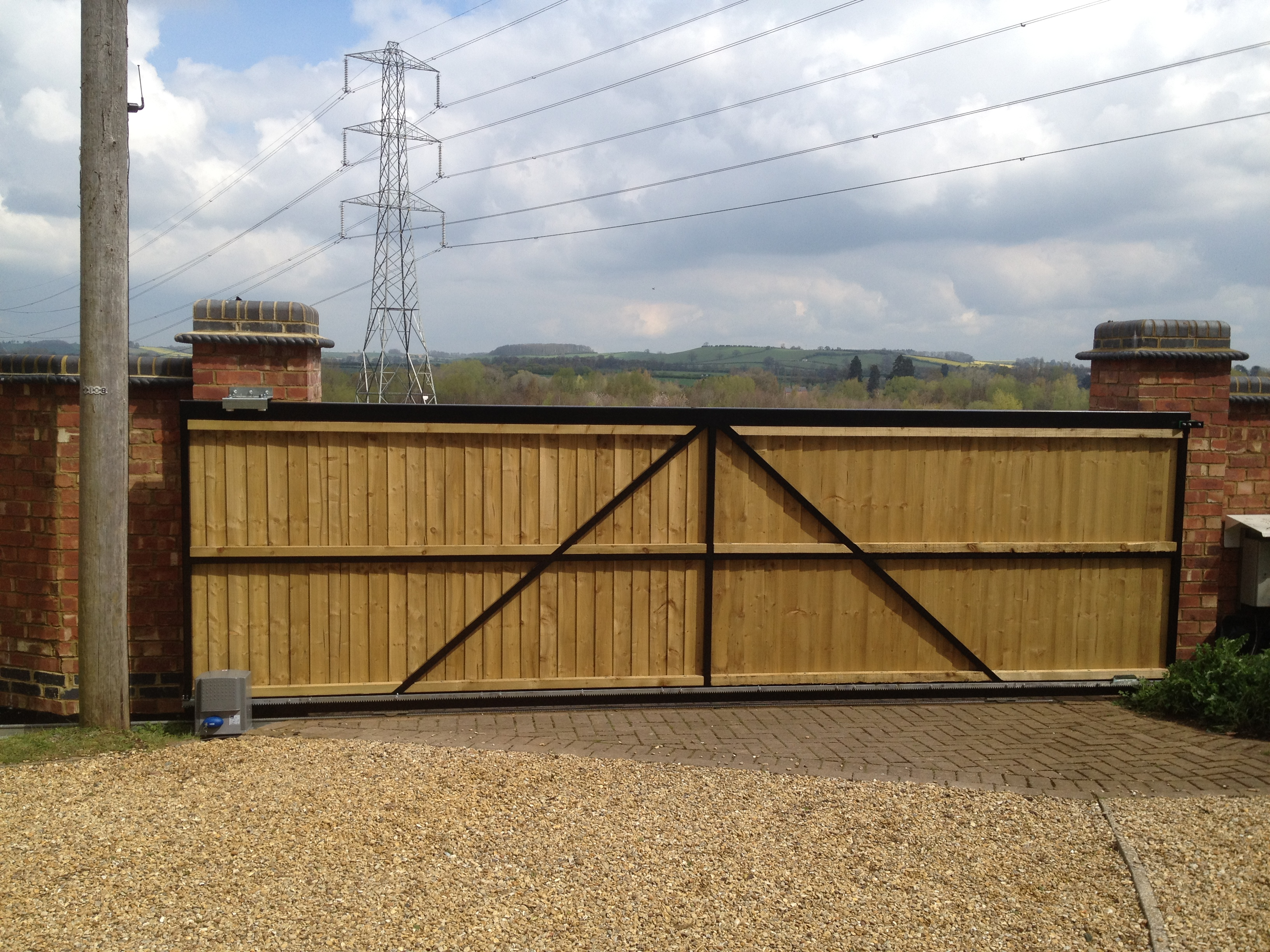 Steel framed tracked sliding gate with a close board fencing infill Rear view