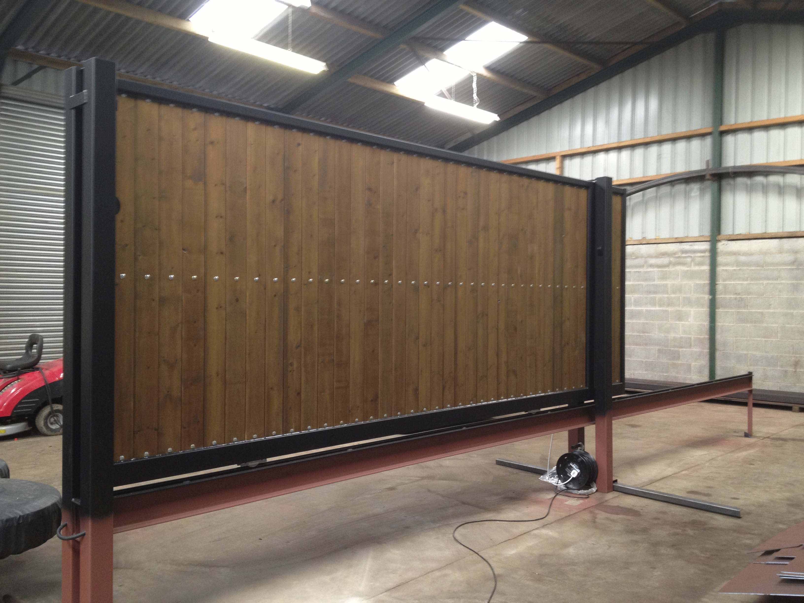 Steel Frame sliding gate with  tongue and groove infill, Pre automated prior to deliver to site