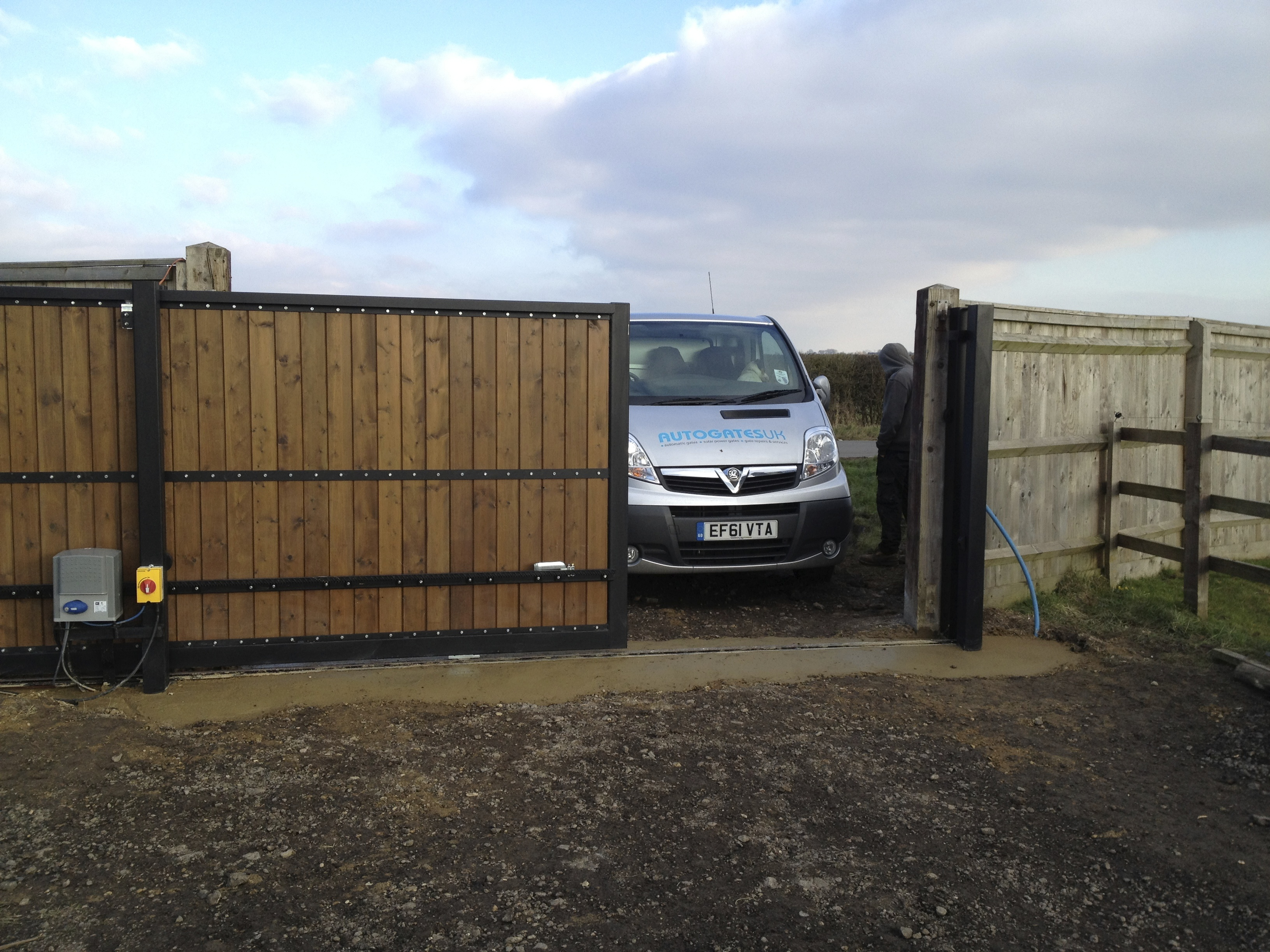 Steel Frame sliding gate with  tongue and groove infill, Pre automated prior to deliver to site installed