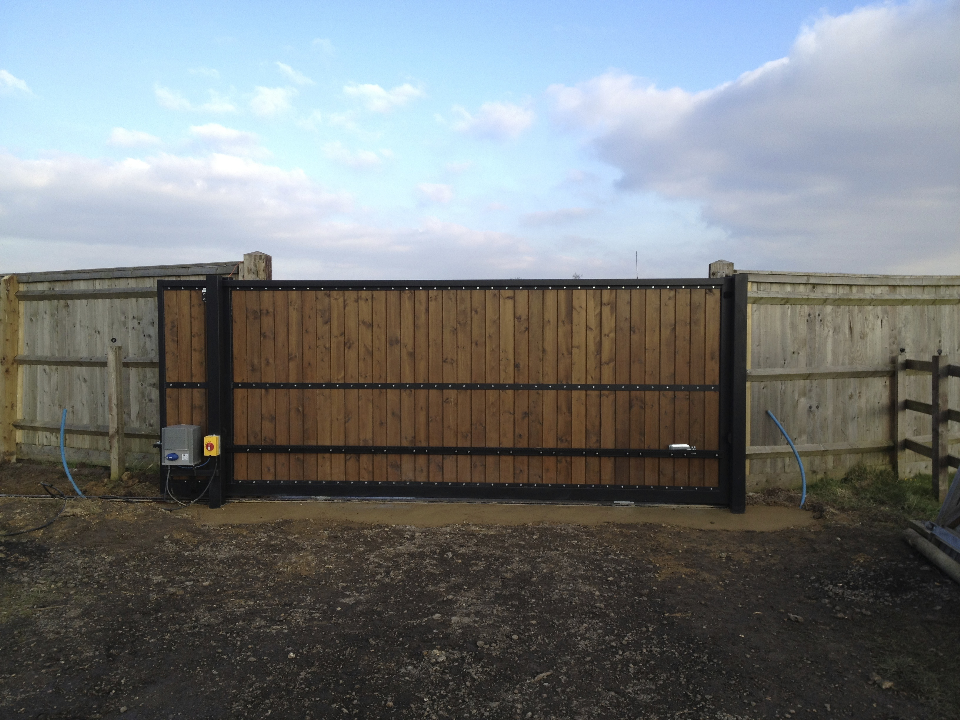 Steel Frame sliding gate with  tongs and groove infill, Pre automated prior to deliver to site installed and closed