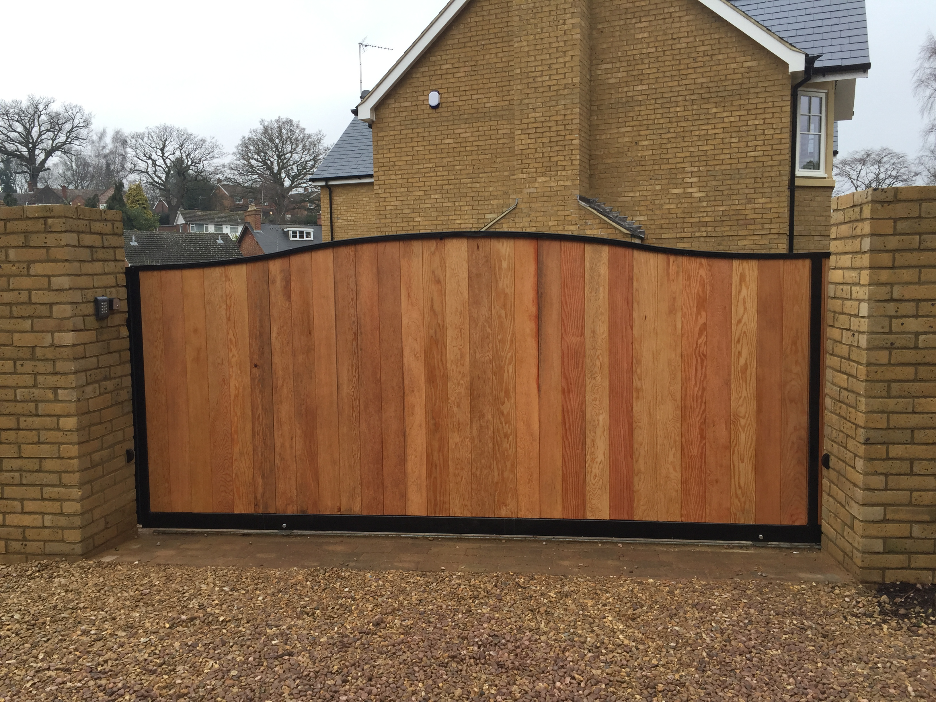 Steel frame tracked sliding gate with T+G infill front