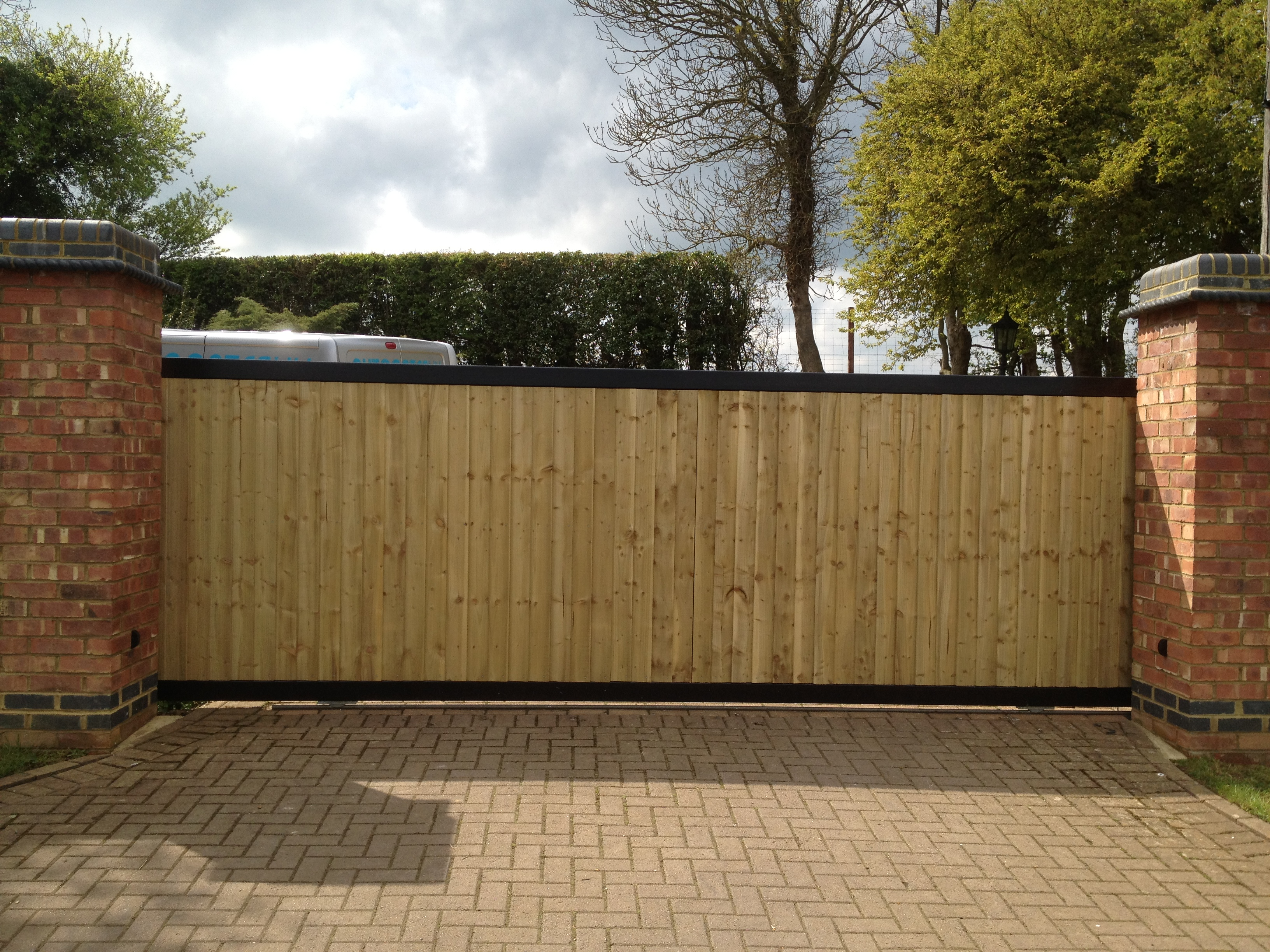 Steel framed tracked sliding gate with a close board fencing infill Front view