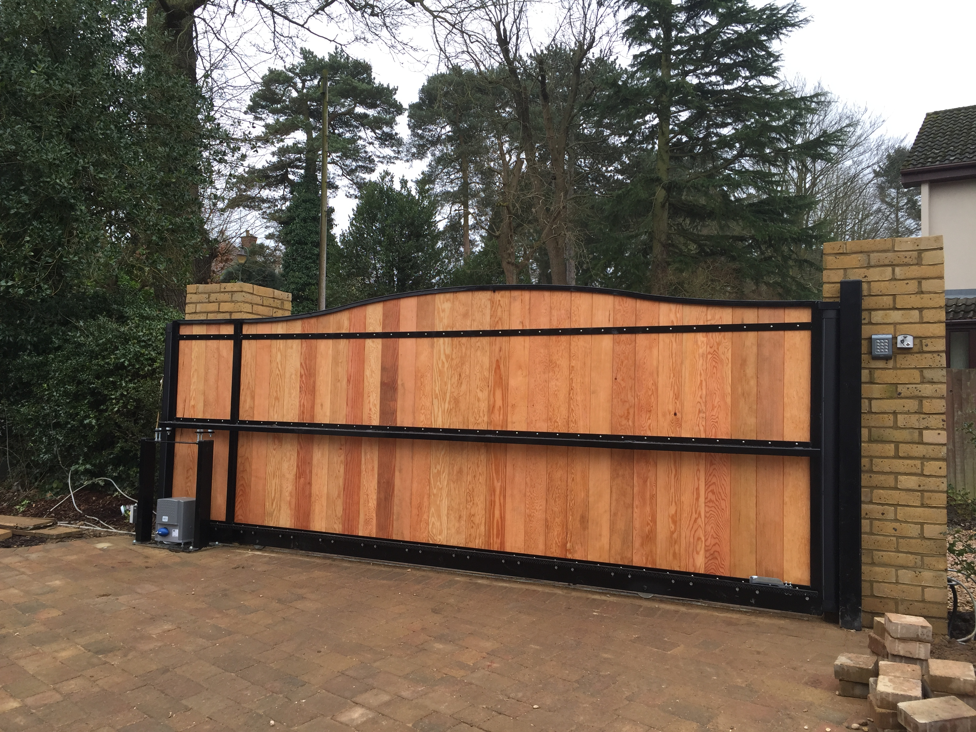 Steel frame tracked sliding gate with T+G infill rear